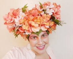 alexis wearing a pink & peach hat made of fake hydrangeas